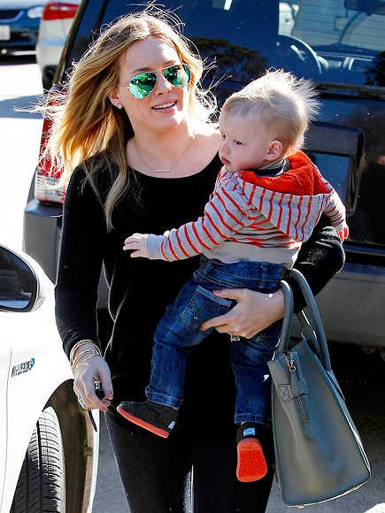 my girl hilary and baby luca, with some of the coolest sunglasses. ever.